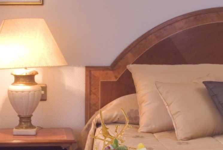 Wooden headboard and cream bedding