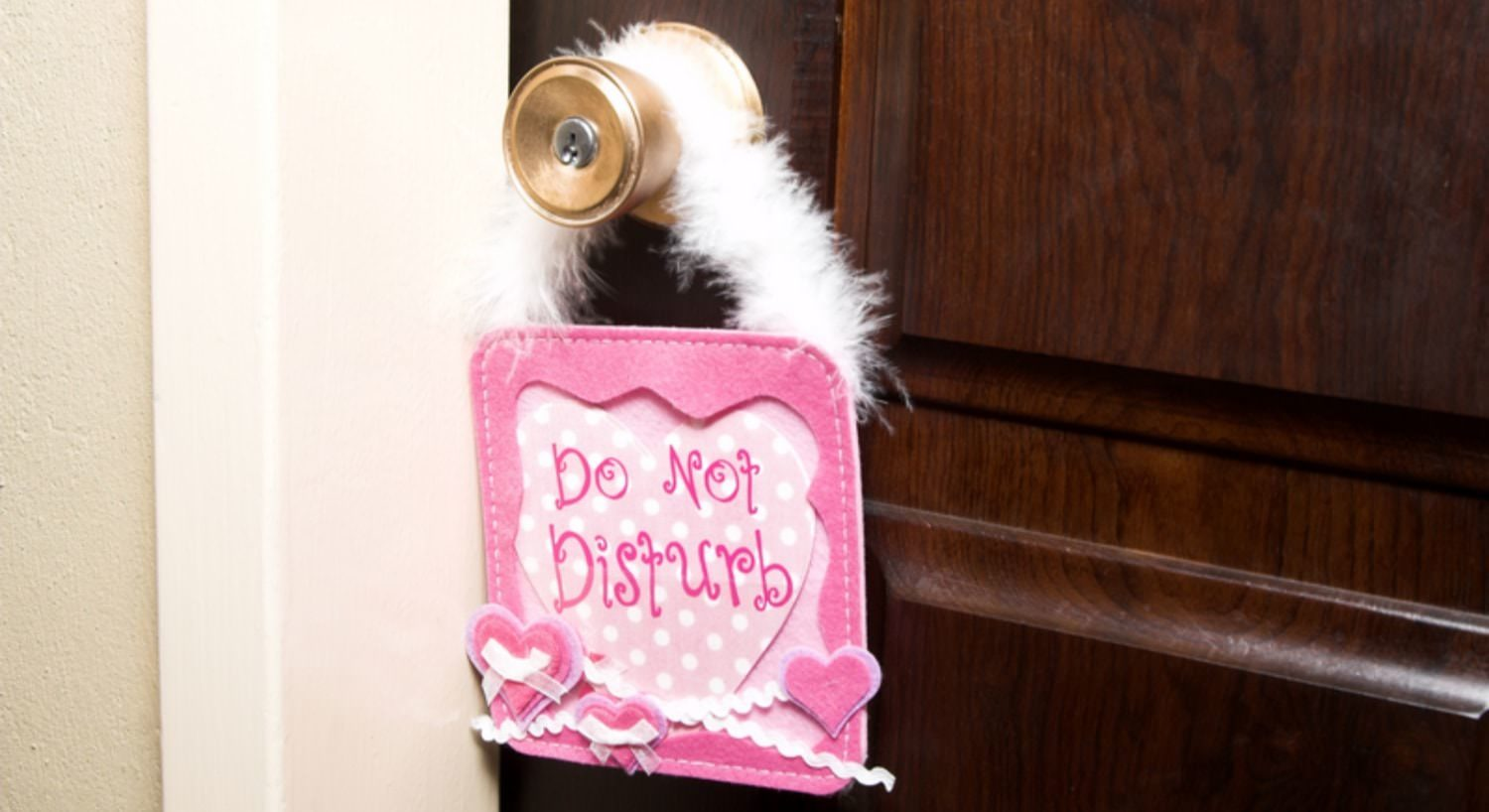 Pink door hanger with Do Not Disturb