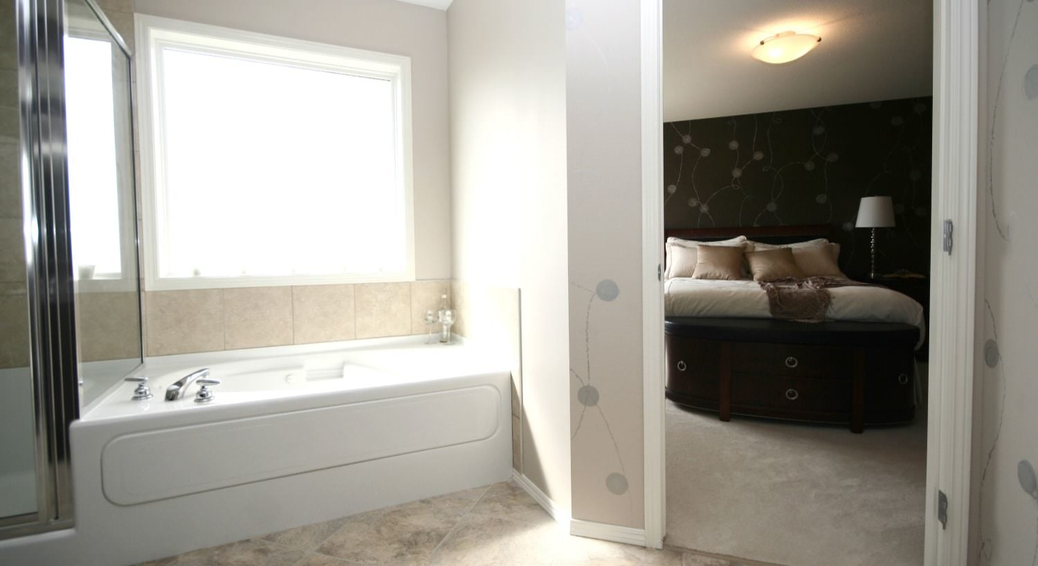 Bathroom with large white tub and separate stand up shower with tiled floor