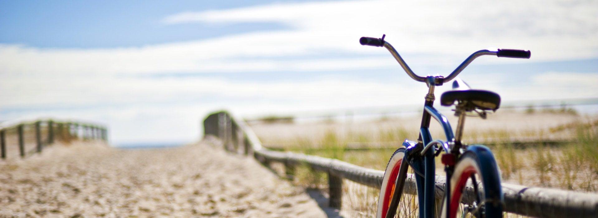 Bike near sandy path to beach