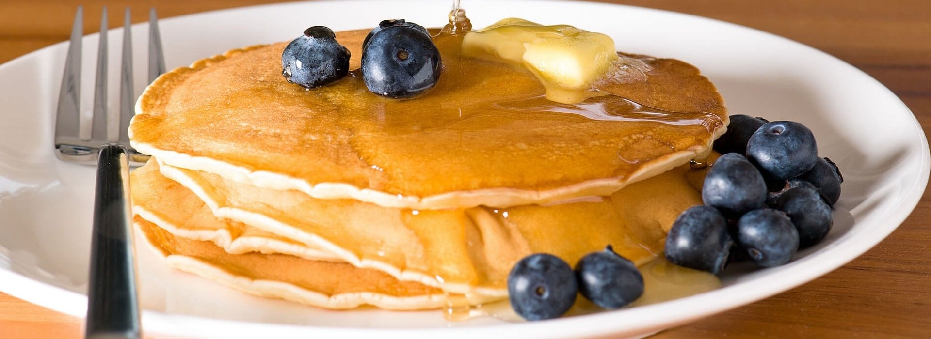 Close up view of pancakes with blueberries on top