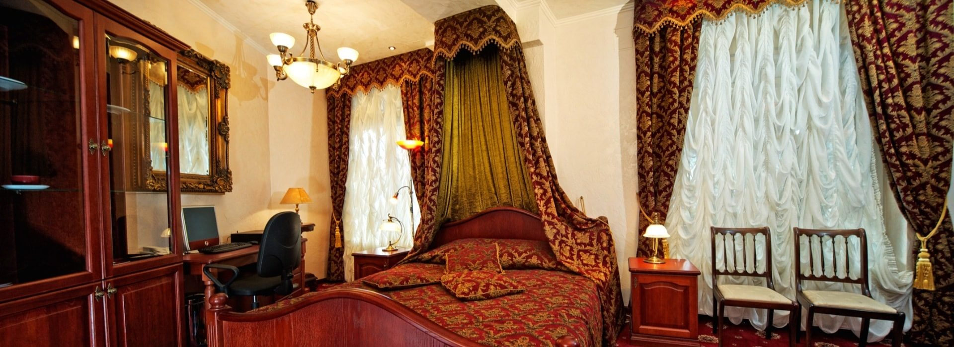 Bedroom with dark wooden bed and furniture