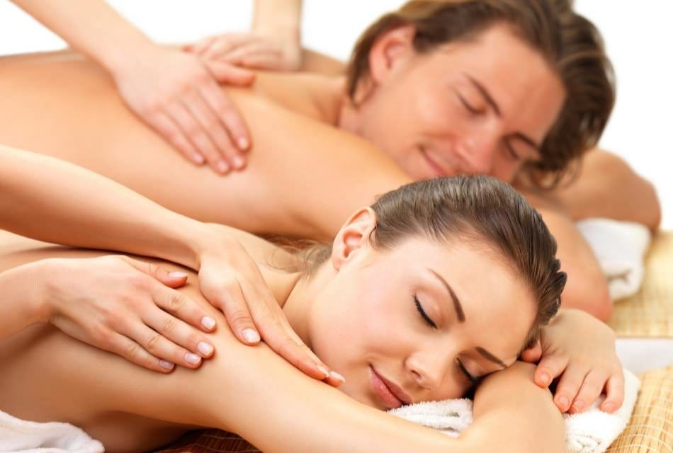Man and woman getting a massage